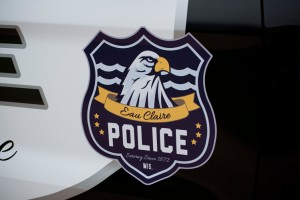 The elements of the logo are seen here, with the water in the background representing Eau Claire, the eagle, and the six stars representing the Eau Claire Police Departments core values.